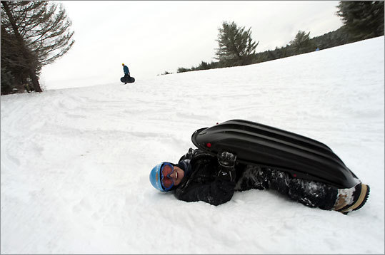 Mary Anne Machis of Stowe is headed the wrong way at Marshall Hill, called the ''town sledding hill.''