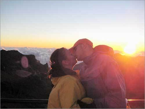 'My husband, Brian, and I on our August 2008 honeymoon. It is Mount Haleakala in Maui, Hawaii, as the sun was rising. While it was a bit cold up there (not your typical 80+ degrees weather in Maui!), this was truly the most breathtaking thing we have ever seen. Amazing!'