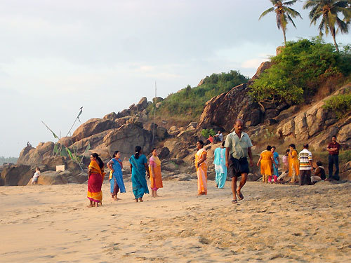 Local residents of Kovalum in southern India. 'My wife and I were on our honeymoon. We couldn't take our eyes off of the women in their beautiful saris on the beach.'