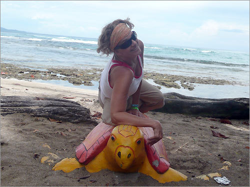 Maureen is relaxing on a tortoise in Puerto Viego, Costa Rica.