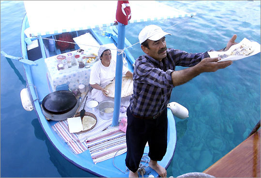 A dory with a couple making and selling crepes approached by the author's vessel off Turkey's coast.