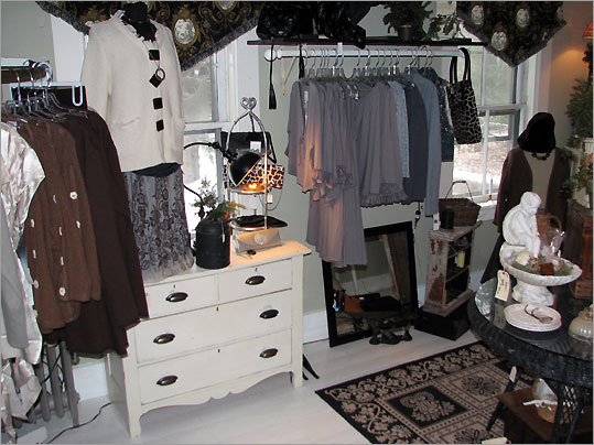 Clothing, vintage accessories, weathered door latches (left) all catch the eye at White Home Collections in Wilton, N.H.