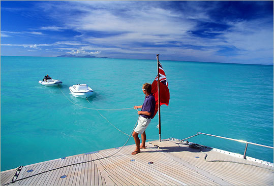 A charter boat in Antigua has tenders ready for ferrying its guests. Charters also carry sea kayaks, snorkels, fins, and other accessories.