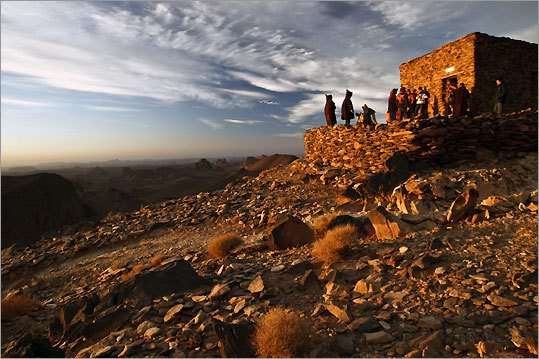 Pilgrims congregate at the hermitage of Pere de Foucauld at Assekrem in the Hoggar Mountains.