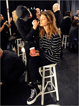Getting ready for the spotlight, a model gets her make-up done before the Nanette Leopre 2009 Fall Show.
