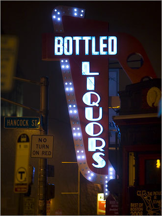 The flashing Bottled Liquors sign points to the small Dana Hill Liquor Mart on Massachusetts Avenue in Cambridge. Built in the 1950s, the sign was restored with LEDs a few years ago.