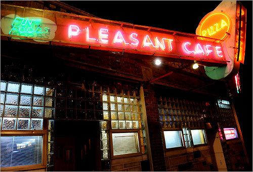 Pleasant Cafe on Washington Street in Roslindale. The establishment's neon sign was created in the 1950s.