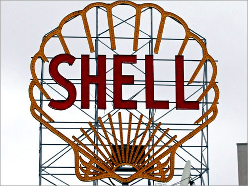 Wiring difficulties had kept the Shell Station sign on Memorial Drive in Cambridge dark for several years, but an exact replica with LED lights replacing the neon ones was lit up in October of 2011 .