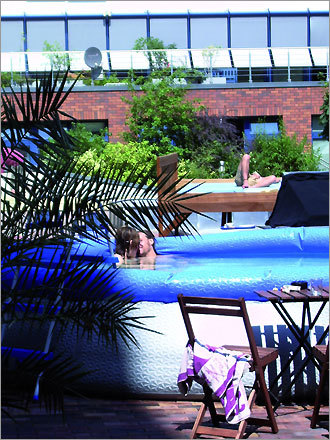 BaxPax Hostel in Berlin features a roof terrace with a paddling pool and views of the city.