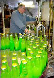 Machines put syrup and carbonated water into bottles before sealing them. Your favorite flavor could be in the cooler lineup.