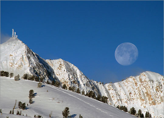 A tram takes skiers to the top of Allen's Peak (left) at Snowbasin Resort in Huntsville, Utah.