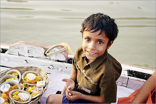 A boy selling offerings by the Ganges River in Varanasi, India.