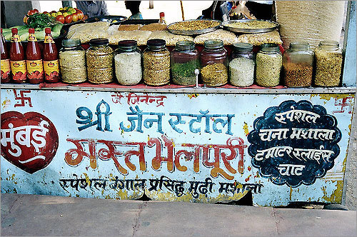 Indian spices and grains for sale on the street.