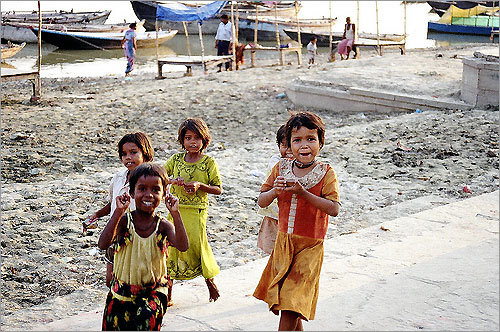 Children playing by the Ganges River.