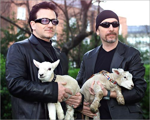 Irish rock band U2's lead singer Bono (left) and guitarist Edge