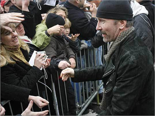 Guitarist The Edge signed autographs before walking into the Somerville Theatre for a soundcheck.
