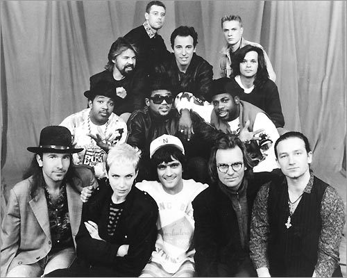 From Bottom left: U2's The Edge, Annie Lennox, Jimmy Iovine, Sting, U2's Bono; (2nd row) RUN-D.M.C.'s Joe Simmons, Darryl McDaniels, Jason Mizelli; (top) Bob Seger, U2's Adam Clayton, Bruce Springsteen, U2's Larry Mullen, and John Cougar Mellencamp.