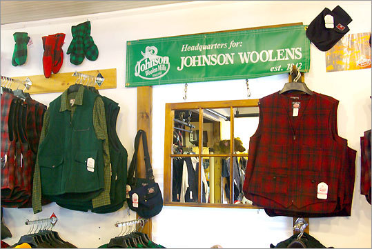 The factory store, where plaid vests, mittens, hats, pants, shirts, and vests are sold, occupies the original woolen mill.