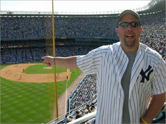 Yankee fan Steve Macary, a.k.a. Steve from Waltham, takes in a Yankees-Red Sox matchup at the old Yankee Stadium last season.