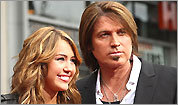 Miley and Billy Ray Cyrus at 'Hannah Montana: The Movie' premiere