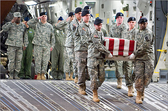 An Army carry team transferred the remains of Army Spc. Israel Candelaria Mejias, of San Lorenzo, Puerto Rico, at Dover Air Force Base. Mejias died April 5 near Baghdad, Iraq, after a mine detonated near him.