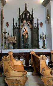 Ecclesiastical antiques fill the vineyard's chapel.