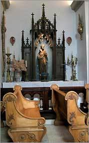 Ecclesiastical antiques fill the vineyard's chapel.