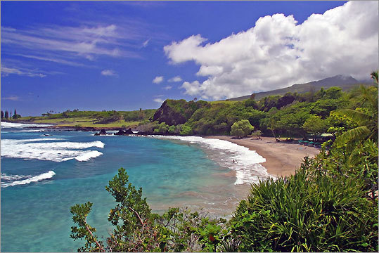 9. Hamoa Beach Maui, Hawaii Dr. Beach says: 'This pocket beach is rimmed by cliffs, covered by coconut palm trees and beautiful flowering vegetation. This crescent beach, which is a mixture of coral and lava sand, is the most famous of Maui's Hana beaches.'