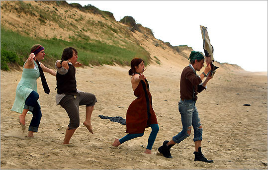 Fish & Bicycle Theatre Company members perform 'Evolution Beach Crawl' at Marconi Beach in Wellfleet.
