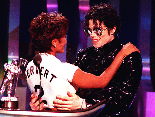 Jackson hugged his sister Janet after they won the 'Best Dance Video' award for their duet 'Scream' at the 1995 MTV Movie Awards.