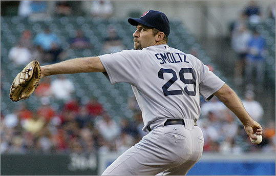 Red Sox starting pitcher John Smoltz delivers a pitch against the Orioles in the first inning at Camden Yards in Baltimore. Smoltz gave up one run on three hits over four innings of work, but didn't return after a 71-minute rain delay in the middle of the fifth inning.