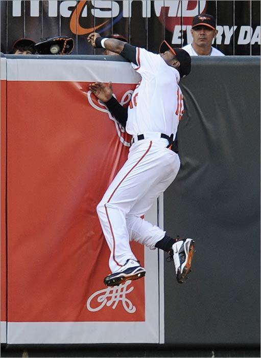 Orioles center fielder Adam Jones loses the ball, and his glove, on a two-run homer from Kevin Youkilis during the first.