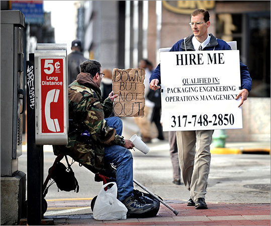"Leave it to an MIT alumnus to innovate. This job-searcher walked the streets of Manhattan wearing a sandwich board that read, ""MIT Grad for Hire."" Pictured: A different job seeker uses a similar technique in Indianapolis earlier this year."