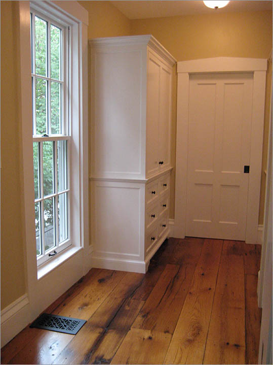 Before the addition of this hallway, the owners of this Cambridge home had no access from the master suite to their childrens' bedrooms. Adding functionality, the hallway doubles as a dressing area with built in wardrobes flanking the doorway.