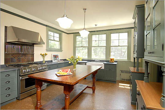 The addition of a row of windows as well as several doorways opens up this Dorchester kitchen and improves traffic flow.