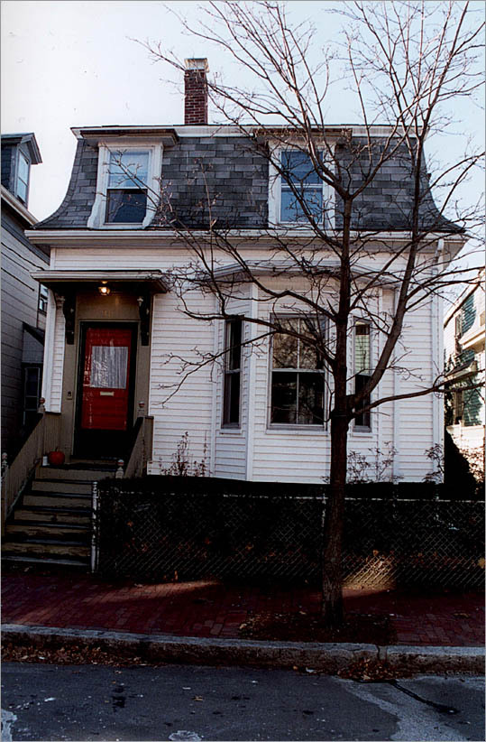 This uninviting Mansard Victorian, clad in vinyl siding, wasn't the neighborhood gem it could have been.