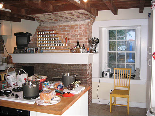 The location of the chimney inside this garden level kitchen cut the space in half and created an awkward layout.