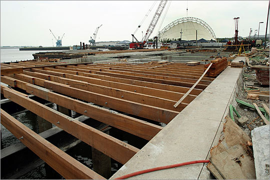 In July 2009, beams were in place on pilings as construction was underway at the new Liberty Wharf on Northern Avenue.