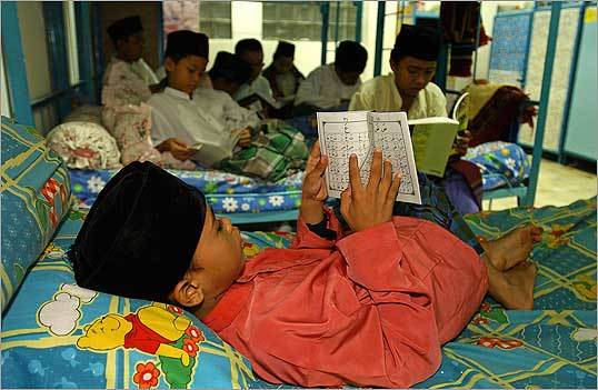 Youngsters study the Koran at a pesantren, or Islamic boarding school, in Indonesia.