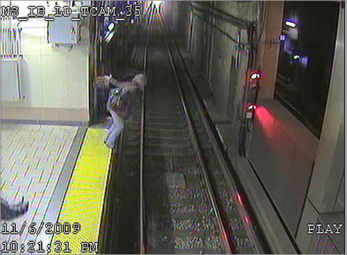 The MBTA today released video and photographs that showed just how close a woman came to being hit by an Orange Line train on Friday when she fell onto the subway tracks at North Station.
