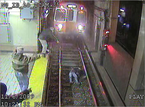 The woman's life had been saved by bystanders who had waved at the train and alerted the operator to stop.