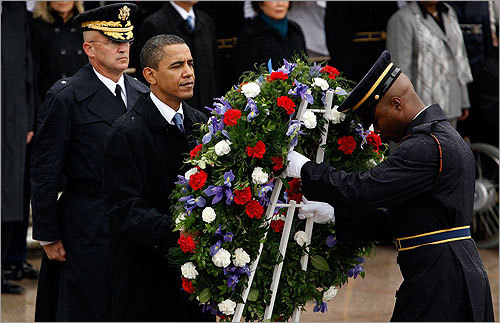 President Barack Obama, assisted by U.S. Army Sgt. First Class Alfred Lanier, placed a wreath at the Tomb of the Unknowns. Obama and his wife, Michelle, later made a surprise visit to family members of fallen soldiers at Arlington National Cemetery and spent some time talking to them.