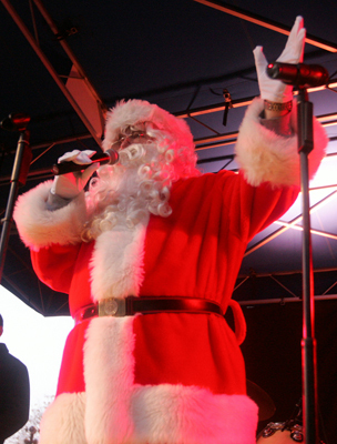 Nov. 21 in Boston the Boston Globe Santa addresses the crowd on stage at the 25th annual tree lighting ceremony at Faneuil Hall Marketplace. The Boston Globe Santa Season was also kicked off on Saturday while Santa and his helpers spent the afternoon collecting donations for the 2009 drive. Learn more Make a donation