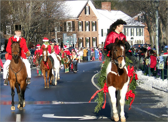 A parade in traditional holiday costume is among the events of Wassail Weekend in Woodstock, Vt.