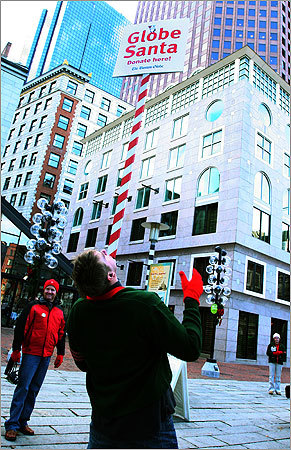 Dec. 10 in Boston Former New England Patriots guard Max Lane balances a Globe Santa sign on his chin in an effort to amuse the people walking around Faneuil Hall and connect with them in an effort to raise money for Globe Santa. Learn more Make a donation