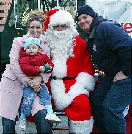 Dec. 10 in Boston Crystal Penders (from left), with her daughter, Georgia-Ann Penders, and husband Jeff Penders made a donation to Globe Santa. Learn more Make a donation