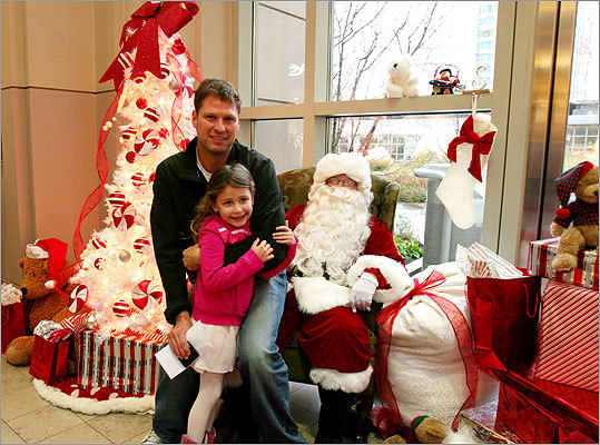 Dec. 5 in Boston Michael Felger, television sports reporter and co-host of Mohegan Sun's Sports Tonight for Comcast SportsNet New England, poses with daughter Emma Felger after they made a donation to help support Globe Santa. Learn more Make a donation