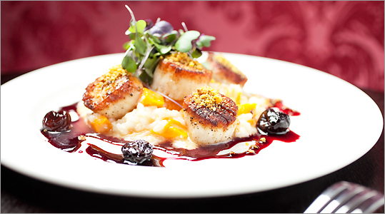 Pan-seared scallops with pistachio crust and a dried cherry glaze
