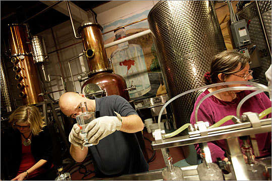 Ryan Soss of Dry Fly checks the amount of gin in a bottle during a group bottling event. In an effort to promote local distilleries, many states recently have legalized liquor tastings at manufacturing facilities and retail outlets, says Frank Coleman, spokesman for the Distilled Spirits Council, which represents big booze makers. Many states also have relaxed blue laws, or prohibition on Sunday liquor sales.