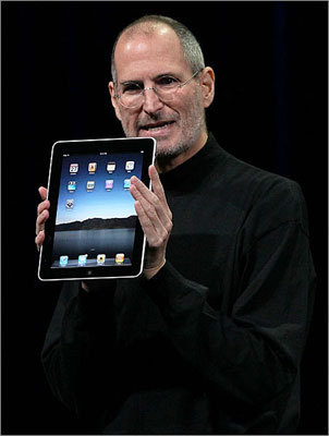 Apple CEO Steve Jobs holds up the iPad at the product's unveiling during a special event in San Francisco in 2010.